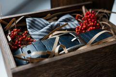 Beautiful gifts, a belt and a bow tie Royalty Free Stock Photos