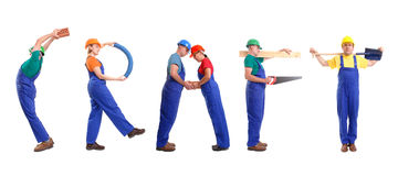 Craft group. Group of young people wearing different color uniforms and hard hats forming Craft word - isolated on white background royalty free stock photography