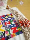 Craft items still life, macrame, cross stitching stock photo