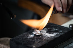 Craft jewelery making. With flame torch royalty free stock image
