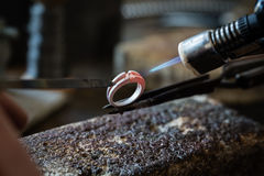 Craft jewelery making with flame torch Royalty Free Stock Photos