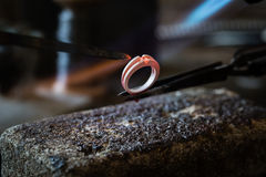 Craft jewelery making with flame torch. royalty free stock photo
