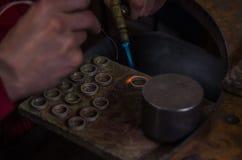 Craft jewelery making with professional tools. Macro shot. A handmade jeweler process, manufacture of jewellery. Melting metal stock photos