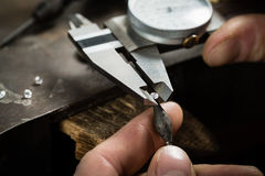 Craft jewellery making. Measuring of the size of the diamond royalty free stock photography