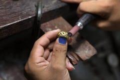 Craft jewelery making. Ring polishing. Royalty Free Stock Photos