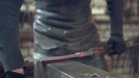 Craft man farrier working in the workshop. Close up stock footage