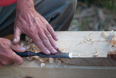 Craft. A man working on wood chisel Royalty Free Stock Image