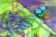 Craft Materials. Colourful fabric, cord, beads Royalty Free Stock Photos