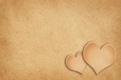Craft paper background with hearts Royalty Free Stock Image