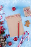 Craft paper card and decoration on blue table top view. Christmas mockup for greeting, plans, wishes, goals. Flat lay. Merry Chraistmas and happy new year 2019 royalty free stock photography