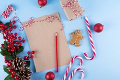 Craft paper card and decoration on blue table top view. Christmas mockup for greeting, plans, wishes, goals. Flat lay. Merry Chraistmas and happy new year 2019 royalty free stock images