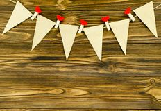 Craft paper  flags with decorative pins  party garland  on woode. N background Royalty Free Stock Photo
