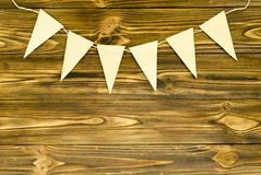Craft paper  flags  party garland  on wooden background.  Stock Photo