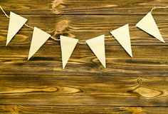 Craft paper  flags  party garland  on wooden background.  Royalty Free Stock Photos