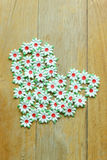 Craft of paper flower placed a heart of Love on wood floor. Royalty Free Stock Photo