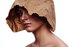 Craft Paper on Head of Woman with beauty Face Royalty Free Stock Photo