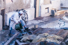 Craft and pollution in Morocco royalty free stock image