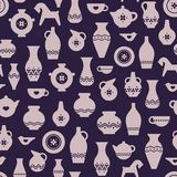 Craft pottery or ceramic seamless pattern. Vases, plates, a cup, teapot. stock illustration