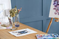 Craft room art studio creative painter workspace. Crafty room. artful studio. creative painter workspace. paintings drawings and watercolors on the table Royalty Free Stock Photo