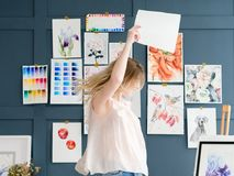 Craft room art studio creative painter workspace. Crafty room. artful studio. creative painter workspace. paintings watercolor drawings on the wall. artist Royalty Free Stock Images