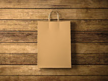 Craft shopping bag on the wooden background. In focus. Horizontal. 3d render. Photo of craft shopping bag on wooden background Stock Photos