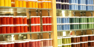 Craft Store Display. Colourful craft bead containers displayed in a hobby store Stock Photography