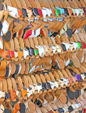 Craft store with many wooden shoes and colored leather Stock Image