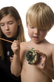 Craft Time. Young boy and girl working on craft projects Royalty Free Stock Photos