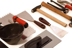 Craft tools. Bricklayers tools, constructions equipments on white backgrounds Stock Image