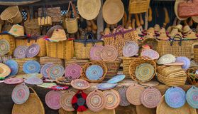 Craft wicker hats, bags and other souvenirs in Morocco market Stock Images