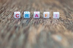 Craft word on wood. Craft word arranged from character cubes on wood table top. closeup. narrow depth of field Royalty Free Stock Images