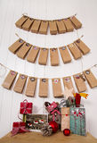Crafted christmas gifts and advent calendar classical in red, gr Stock Image