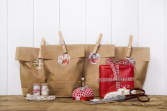 Crafted christmas presents wrapped in paper bags with wooden cli Royalty Free Stock Images
