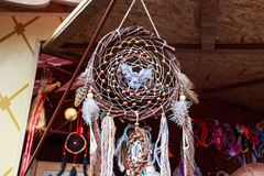 Crafted dream catcher souvenir with owl in center royalty free stock image