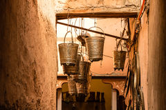 Crafted hanging silver buckets Stock Images