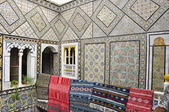 Crafted walls of an ancient house with carpets Royalty Free Stock Photos
