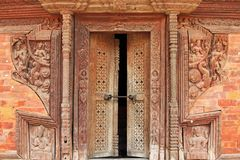 Crafted wooden doorframe and wall decoration in Kathmandu, Nepal Stock Images