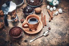 Crafting coffee in clay cup with bean Stock Photography