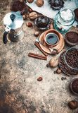 Crafting coffee in clay cup with bean. Cezve and chocolate cake top view on grunge background Stock Image