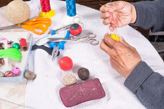 Crafting leather balls. Skilled hands crafting leather balls for traditional pelota sport Stock Photos