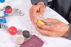 Crafting leather balls. Skilled hands crafting leather balls for traditional pelota sport Stock Photo