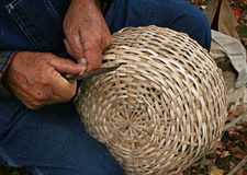 Crafting old-fashioned wicker basket Stock Photos