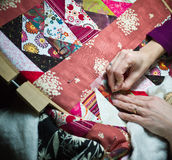 Crafting a quilt. A woman works on her handmade quilting craft project Stock Photography
