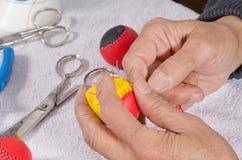 Crafting sport balls. Expert hands crafting traditional sport balls Stock Photos