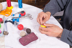 Crafting traditional leather balls. Skilled hands crafting leather balls for traditional pelota sport Royalty Free Stock Photo