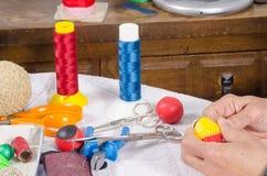 Crafting traditional sport balls. Expert hands crafting traditional sport balls Stock Photos