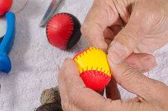 Crafting traditional sport balls. Expert hands crafting traditional sport balls Royalty Free Stock Photo