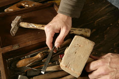 Craftman carpenter hand tools artist. Craftmanship Stock Images