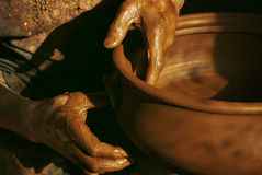 Craftman. Close-up on potters hands making clay pottery Stock Photo