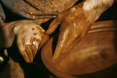 Craftman. Close-up on potters hands making clay pottery Stock Image